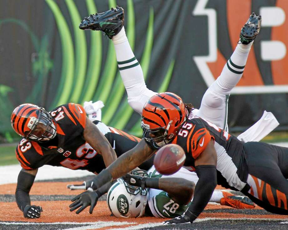 Bengals outside linebacker Vontaze Burfict (55) and strong safety George Iloka (43) break up a pass intended for New York Jets tight end Jeff Cumberland in the end zone during Sunday's game in Cincinnati. Photo: David Kohl — The Associated Press  / FR51830 AP
