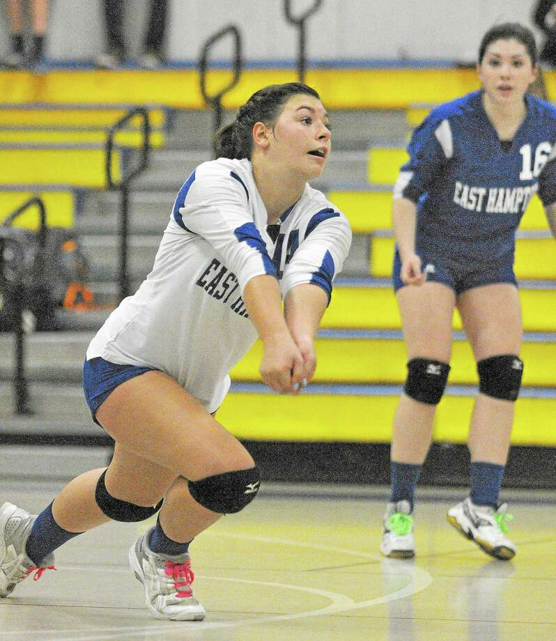 Catherine Avalone — The Middletown Press East Hampton's Grace Fales gets ready to bump the ball against Haddam-Killingworth in a Shoreline Semifinal game Thursday afternoon in Higganum. East Hampton won 3-1. Photo: Journal Register Co. / TheMiddletownPress