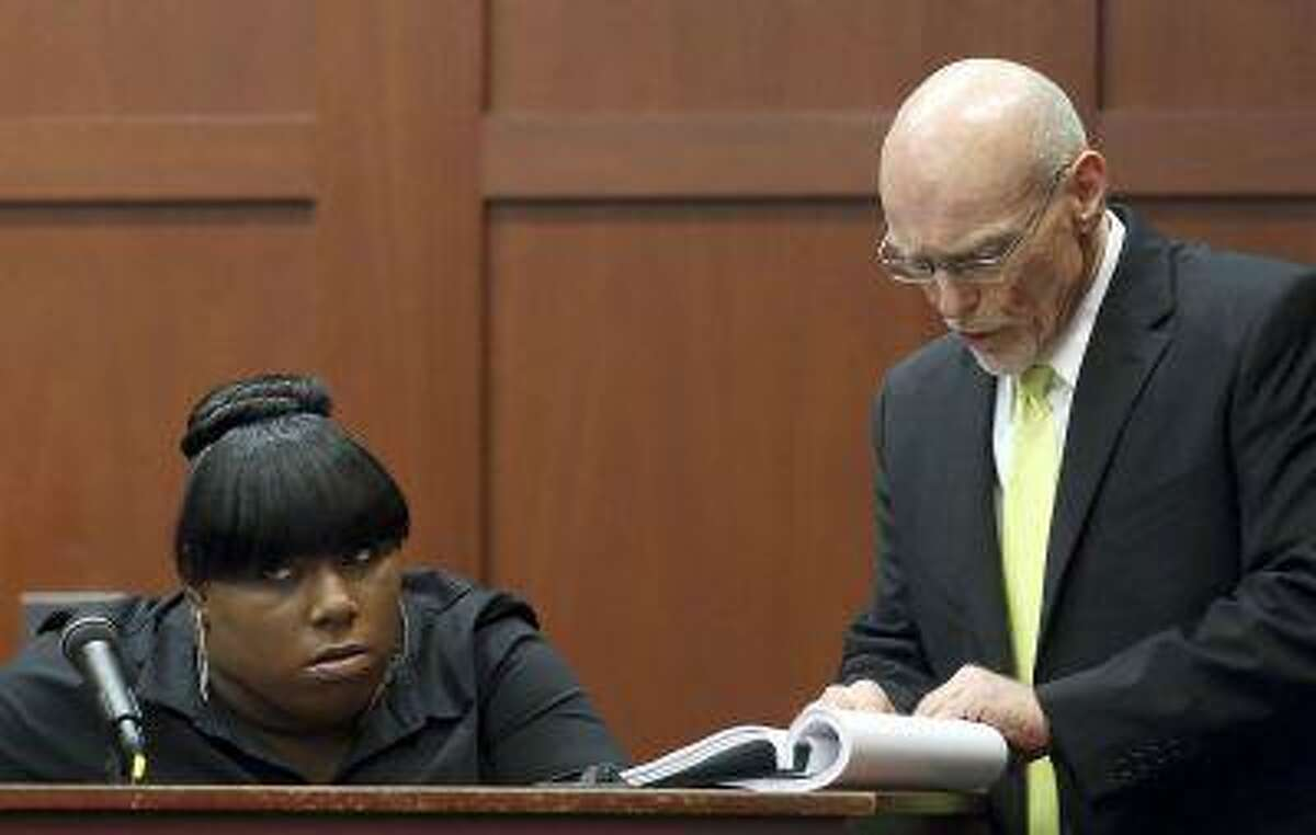 Witness Rachel Jeantel looks on while on the stand as defense attorney Don West makes a point during George Zimmerman's second-degree murder trial for the 2012 shooting death of Trayvon Martin in Seminole circuit court in Sanford, Florida, June 26, 2013.