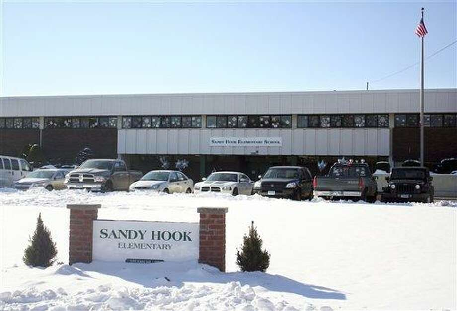 This photo provided by the Monroe Police Department shows the new Sandy Hook Elementary School on the first day of classes in Monroe, Conn., Thursday, Jan. 3, 2013. The school, formerly known as Chalk Hill School, was overhauled especially for the students from the Sandy Hook School shooting in Newtown, in the neighboring town of Monroe, Conn. (AP Photo/Monroe Police Department) Photo: ASSOCIATED PRESS / AP2013