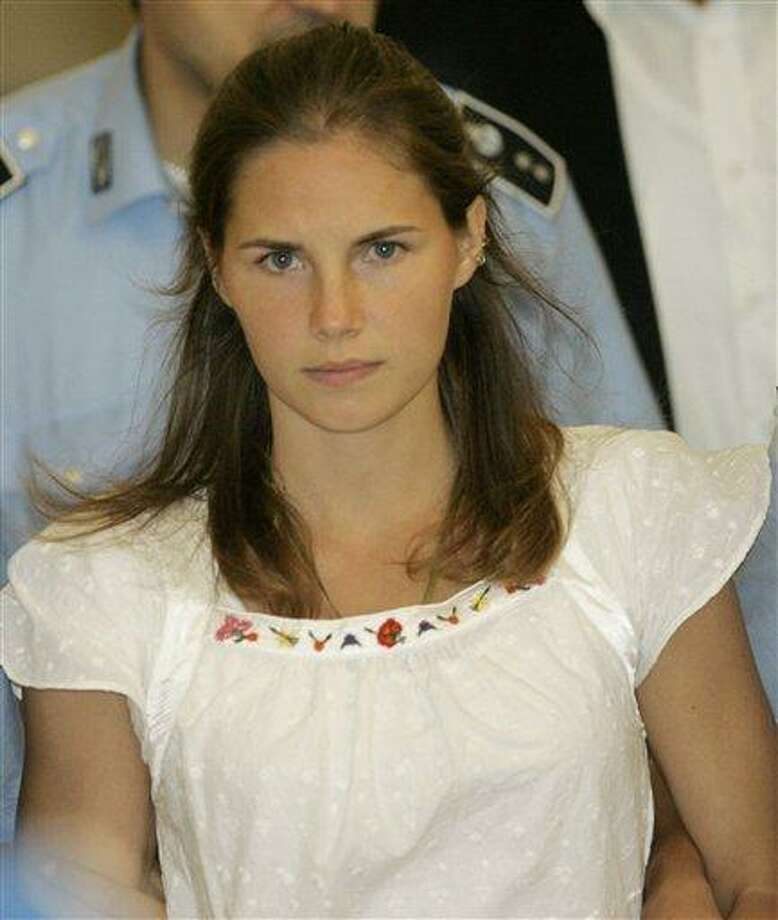 American murder suspect Amanda Knox is escorted by Italian penitentiary police officers from Perugia's court after a hearing in 2008. Italian prosecutors have appealed to Italy's highest criminal court a decision throwing out the murder conviction against Amanda Knox and her former Italian boyfriend in the brutal slaying of a British student. Associated Press file photo Photo: AP / AP