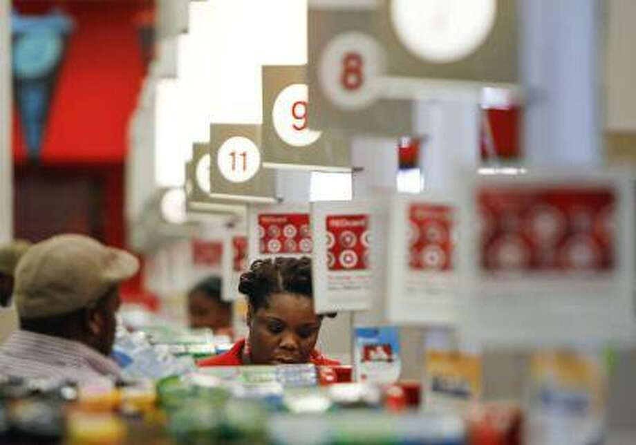 A cashier rings up a sale at a Target store in Chicago on Wednesday, Aug. 22, 2012. (AP Photo/Sitthixay Ditthavong) Photo: ASSOCIATED PRESS / AP2012