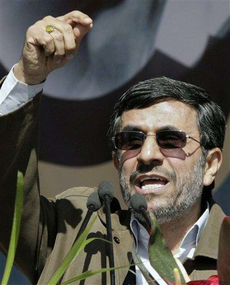 "Iranian President Mahmoud Ahmadinejad gestures Saturday as he deliver his speech at a rally to mark the 33rd anniversary of the Islamic Revolution that toppled the country's pro-Western monarchy and brought Islamic clerics to power. Ahmadinejad says Iran will soon reveal ""very big new nuclear achievements.""  Associated Press Photo: AP / AP"