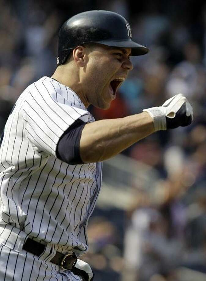 New York Yankees' Russell Martin reacts after hitting a game-winning walk-off home run in the Yankees' 5-4 victory over the New York Mets in a baseball game at Yankee Stadium in New York, Sunday, June 10, 2012.  (AP Photo/Kathy Willens) Photo: ASSOCIATED PRESS / AP2012