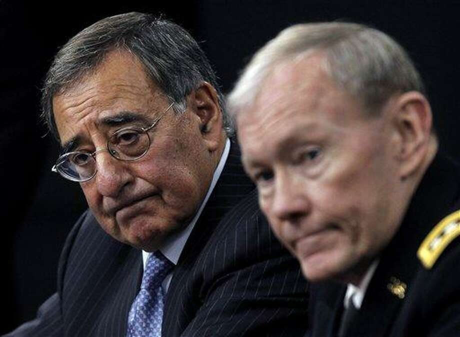 Defense Secretary Leon Panetta and Joint Chiefs Chairman Gen. Martin E. Dempsey outline the main areas of proposed defense spending cuts during a news conference at the Pentagon. Associated Press file photo Photo: ASSOCIATED PRESS / AP2012