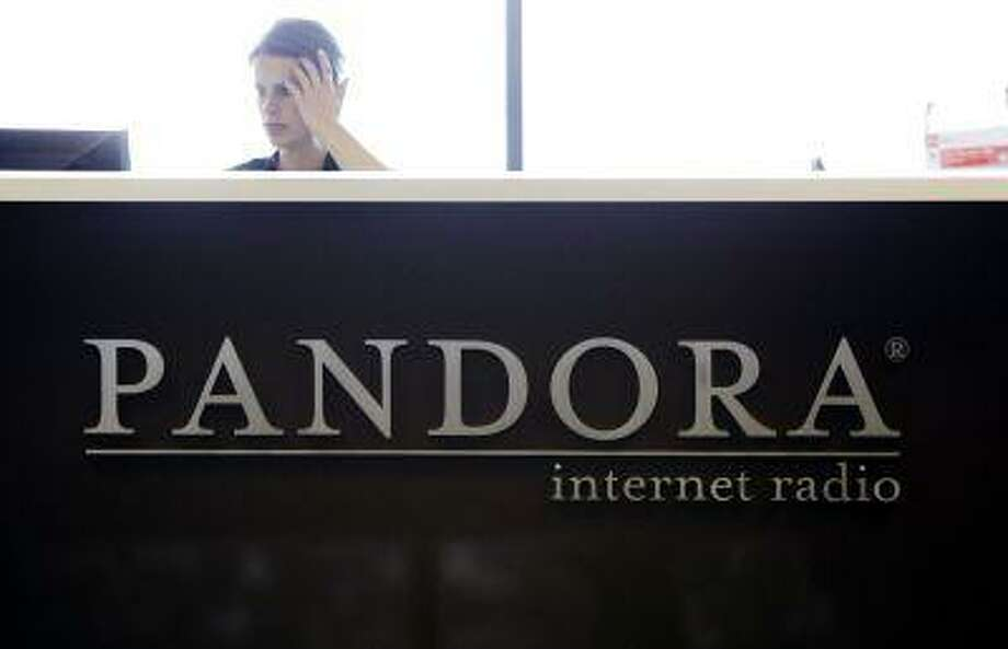 In this June 14, 2011 photo, an employee works in the lobby of Pandora headquarters in Oakland, Calif., Tuesday, June 14, 2011. The shares of popular but unprofitable Internet radio service Pandora Media Inc. soared more than 50 percent in its market debut Wednesday, June 15. (AP Photo/Paul Sakuma) Photo: ASSOCIATED PRESS / AP2011