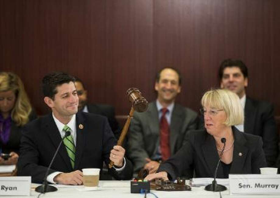 Rep. Paul Ryan, R-Wisc., and Sen. Patty Murray, D-Wash., eye the ceremonial gavel before the start of the House-Senate Conference Committee on the congressional budget. / © 2013 CQ Roll Call