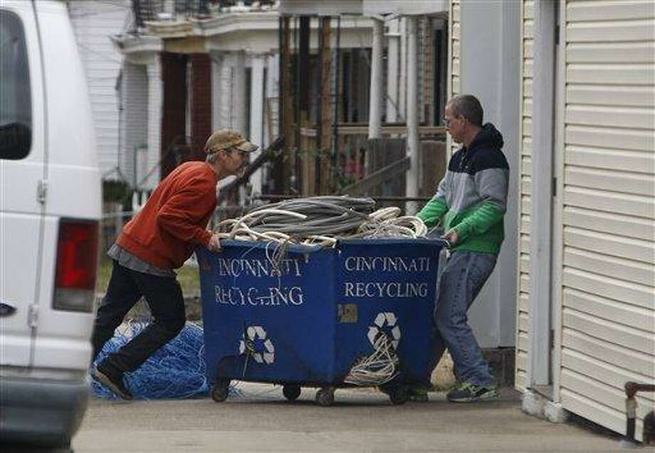 Employees of Cincinnati Recycling in East Price Hill move a tub of wires, brought by a customer, into their processing facility in Cincinnati, Ohio. Cincinnati is working to curb thefts of scrap metal is considering stricter metal sales regulations described by some as unique within the state and perhaps in the country. Associated Press Photo: AP / Cincinnati Enquirer