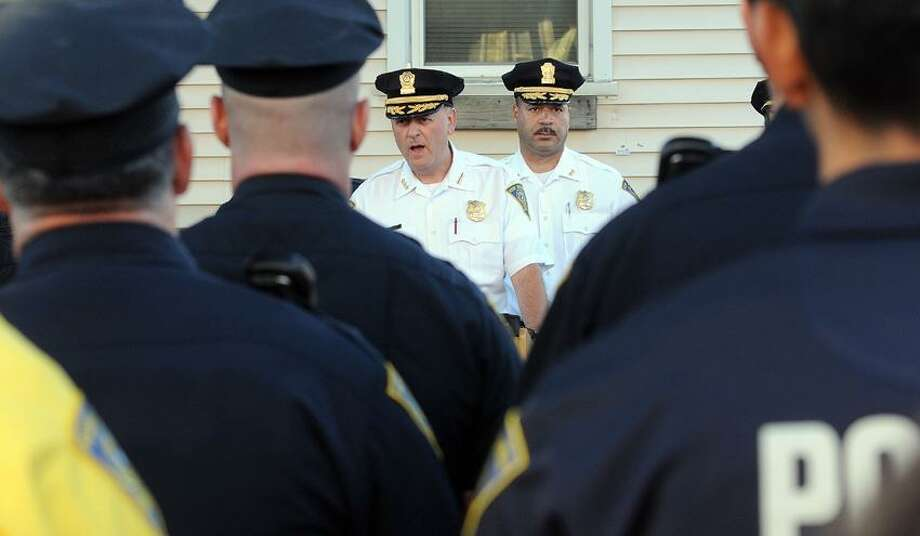 The New Haven Police Department held a B Squad roll call on Kensington Street in front of the site of a shooting that injured toddler Tramire Miller. Chief Dean Esserman, center left, addresses the squad with Assistant Chief Luiz Casanova, center right. Mara Lavitt/New Haven Register