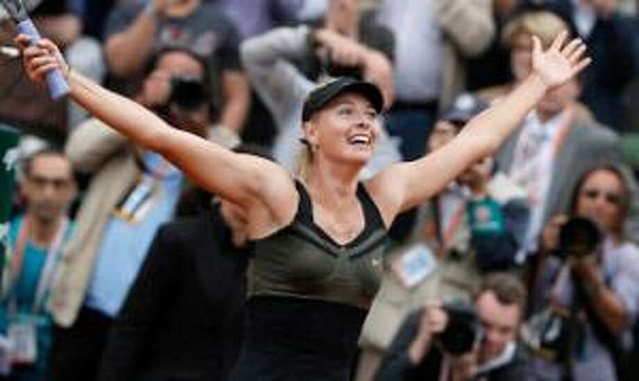 ASSOCIATED PRESS Maria Sharapova of Russia celebrates winning the women's final match against Sara Errani of Italy at the French Open tennis tournament in Roland Garros stadium in Paris on Saturday. Sharapova won in two sets 6-3, 6-2.