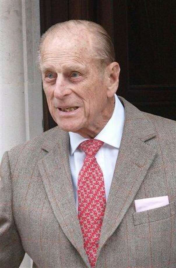 Prince Philip, Duke of Edinburgh, leaves King Edward VII Hospital in central London Saturday after being treated for a bladder infection. The duke will celebrate his 91st birthday Sunday privately with members of the family. On Friday he enjoyed the company of grandsons the Duke of Cambridge and Prince Harry who paid a short, private visit to the hospital.  Associated Press Photo: AP / PA