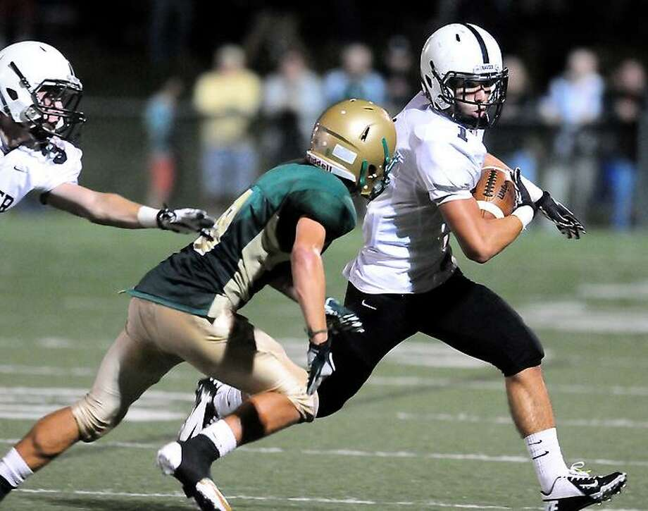 Christopher Perry (center) of Notre Dame of West Haven pursues Andrew Meoli (right) of Xavier runs in the second half in West Haven on 9/14/2012.Photo by Arnold Gold/New Haven Register