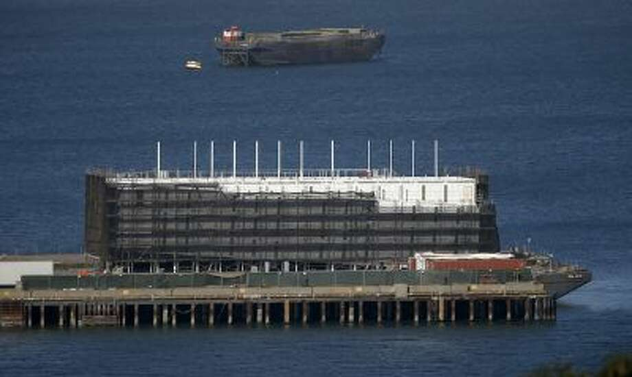 A mystery barge, looking north, along Pier 1 in Treasure Island, Calif. on Monday, October 28, 2013. Photo: San Jose Mercury News / San Jose Mercury News