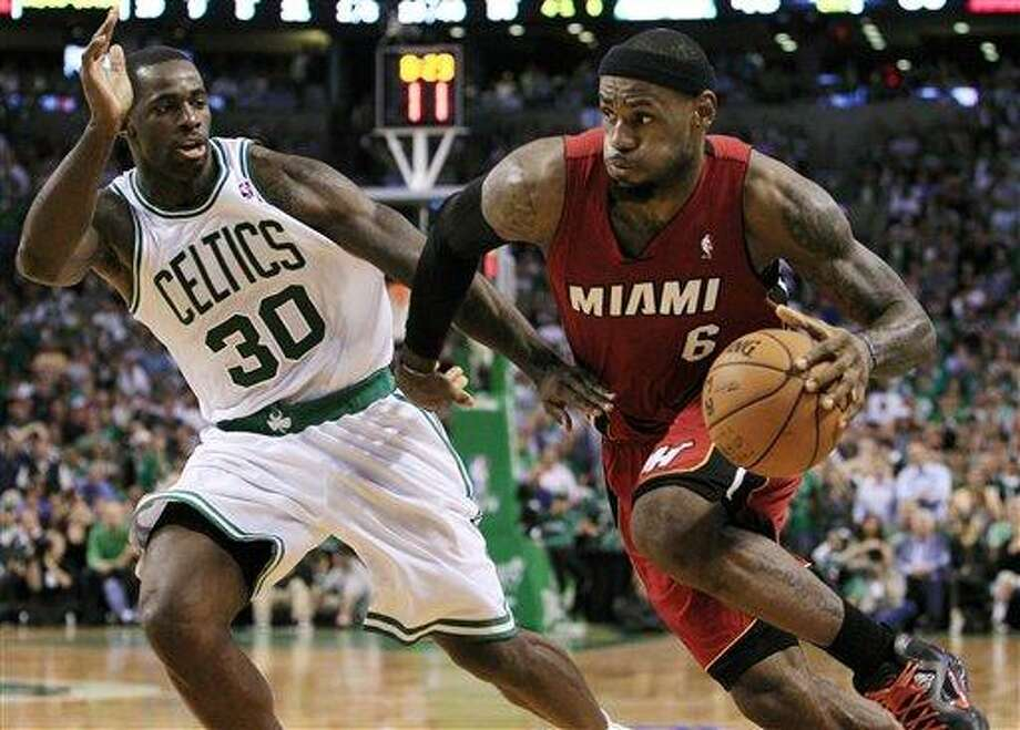 Miami Heat forward LeBron James (6) drives against Boston Celtics forward Brandon Bass (30) during the third quarter in Game 6 of the NBA basketball Eastern Conference finals, Thursday, June 7, 2012, in Boston. (AP Photo/Elise Amendola) Photo: ASSOCIATED PRESS / AP2012