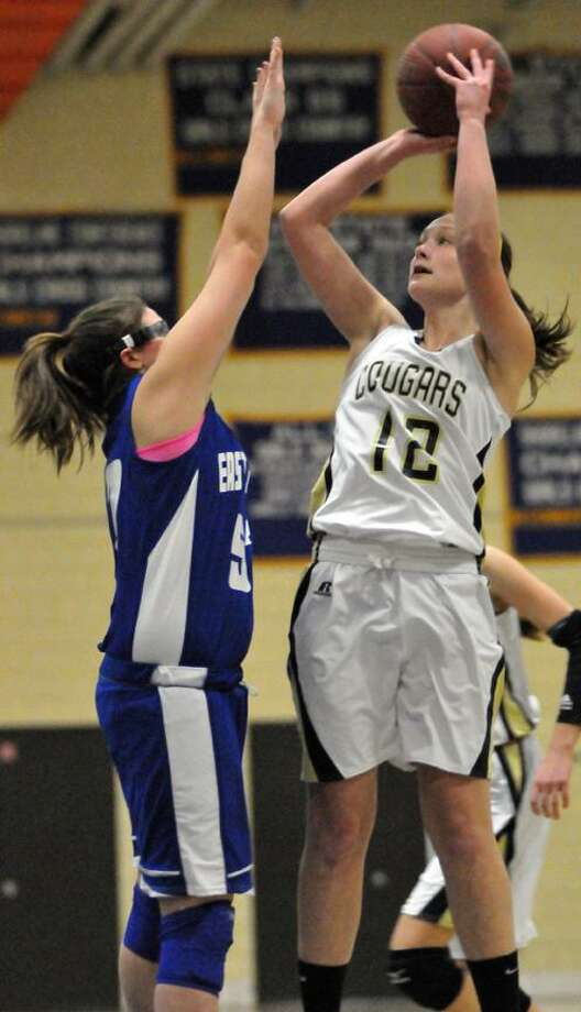 Catherine Avalone/The Middletown PressHaddam-Killingworth sophomore center/forward Jessica Kasper shoots over East Hampton junior forward/center Megan Close Monday night in Higganum. The H-K Cougars defeated the East Hampton Bellringers 48-22 in the . / TheMiddletownPress