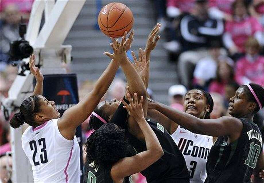 Connecticut's Kaleena Mosqueda-Lewis, left, and Morgan Tuck, second from right, battle for a rebound with Baylor's Odyssey Sims, second from left, Brooklyn Pope, center, and Destiny Williams, right, during the first half of an NCAA college basketball game in Hartford, Conn., Monday, Feb. 18, 2013. (AP Photo/Jessica Hill) Photo: AP / FR125654 AP