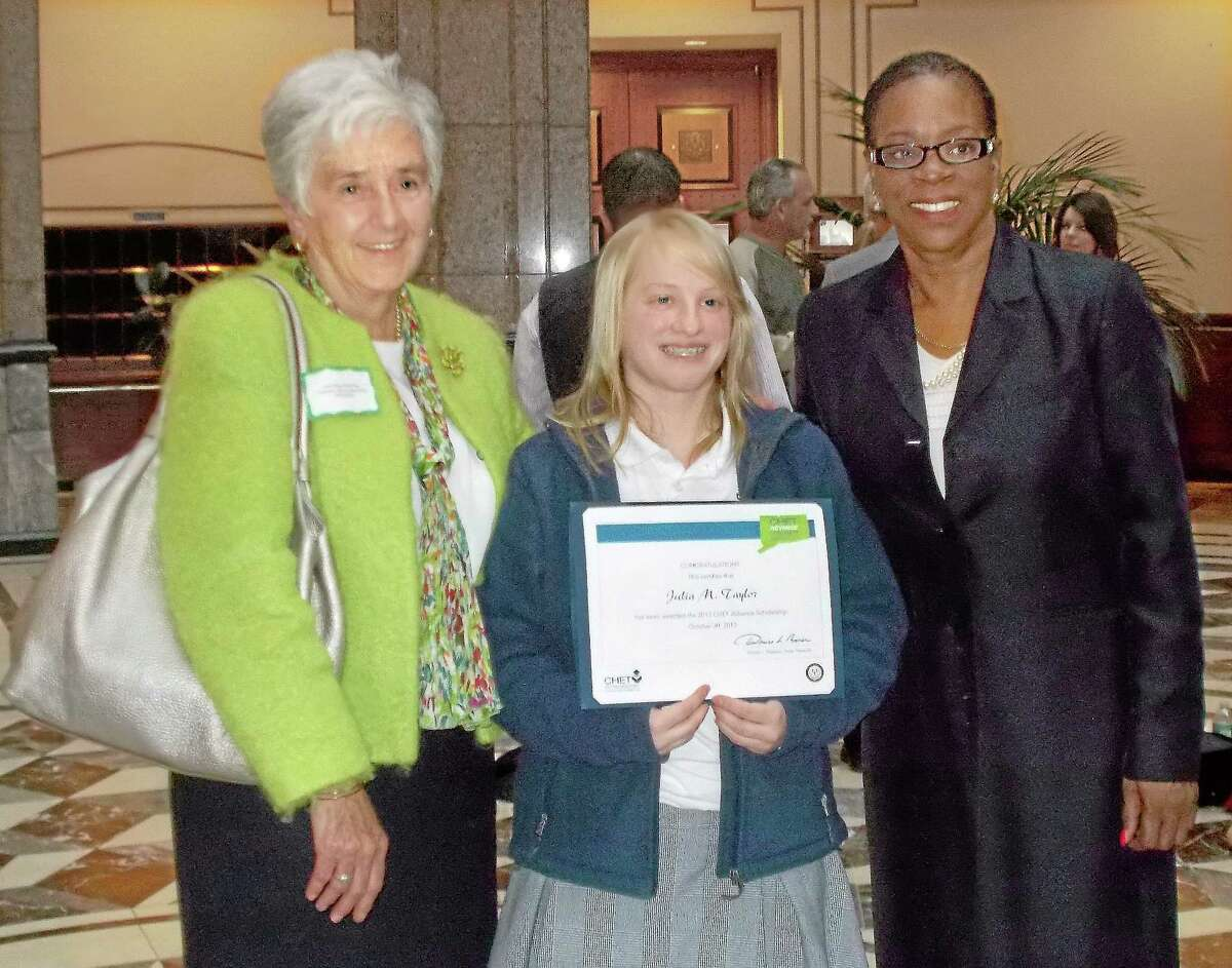 Left to right, Sister Mary McCarthy, Mercy High student Julia Taylor and state Treasurer Denise Nappier.