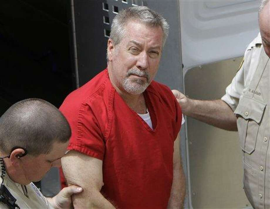 FILE - In this May 8, 2009 file photo, former Bolingbrook, Ill., police sergeant Drew Peterson arrives at the Will County Courthouse in Joliet, Ill., for his arraignment on charges of first-degree murder in the 2004 death of his former wife Kathleen Savio, who was found in an empty bathtub at home. Peterson's wisecracking, limelight-hogging, sunglasses-wearing lawyers faced the media horde every day of the former suburban Chicago police officer's 2012 trial -- one that ended with a murder conviction and a falling out among the erstwhile colleagues. But the lawyerly war of words in public between lead trial counsel Joel Brodsky and former partner-turned-nemesis Steve Greenberg that began within hours of the trial's end will come to a head Tuesday, Feb. 19, 2013 at a hearing where the defense will argue Peterson deserves a new trial because Brodsky did a shoddy job. (AP Photo/M. Spencer Green, File) Photo: AP / AP
