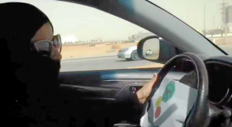 In this image made from video provided by theOct26thDriving campaign, which has been authenticated based on its contents and other AP reporting, a Saudi woman drives a vehicle in Riyadh, Saudi Arabia, Saturday, Oct. 26, 2013. A Saudi woman said she got behind the wheel Saturday and drove to the grocery store without being stopped or harassed by police, kicking off a campaign protesting the ban on women driving in the ultraconservative kingdom. (AP Photo) Photo: AP / theOct26thDriving campaign