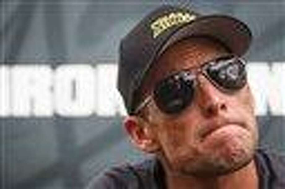Seven-time Tour de France champion Lance Armstrong grimaces during a news conference after the Memorial Hermann Ironman 70.3 Texas triathlon in Galveston, Texas. AP Photo/Houston Chronicle, Michael Paulsen Photo: AP / Houston Chronicle