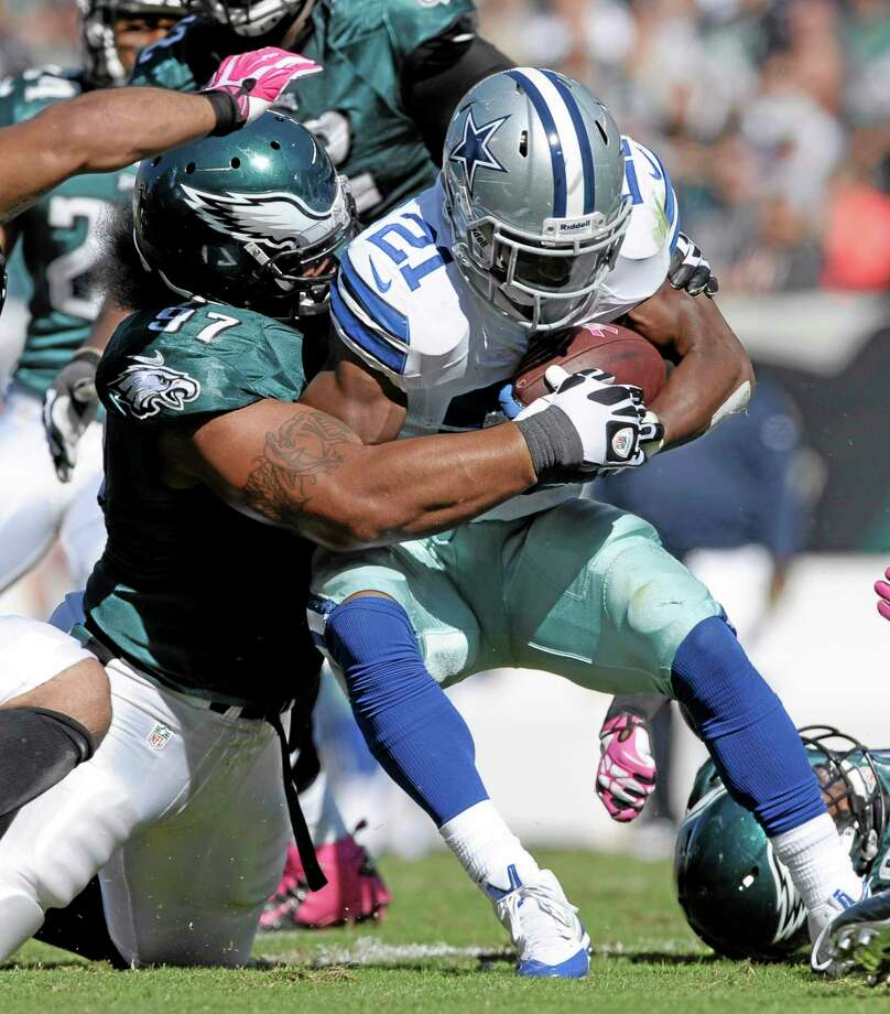 Dallas Cowboys running back Joseph Randle (21) is stopped by Eagles nose tackle Isaac Sopoaga (97) during the first half of Oct. 20's game in Philadelphia. The New England Patriots acquired Sopoaga from the Eagles Tuesday along with a sixth-round pick in 2014 for a fifth-rounder next year. The 32-year-old Sopoaga helps replace Pro Bowl nose tackle Vince Wilfork, who is out for the season. Photo: Michael Perez — The Associated Press  / FR168006 AP