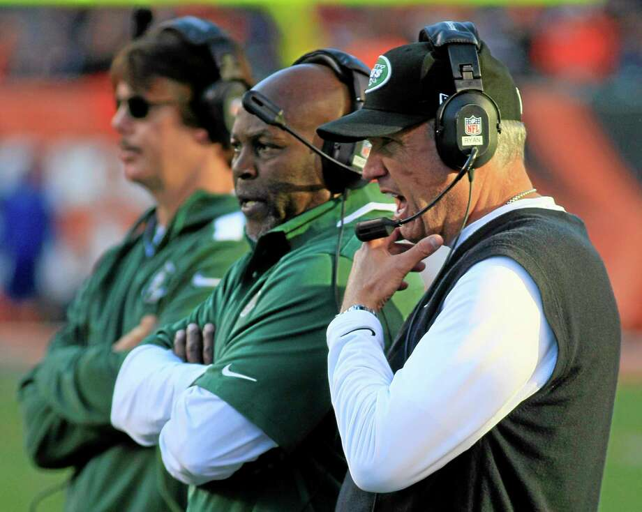 New York Jets head coach Rex Ryan, right, watches on the sidelines during the first half of Sunday's game against the Bengals in Cincinnati. Photo: Tom Uhlman — The Associated Press  / FR31154 AP