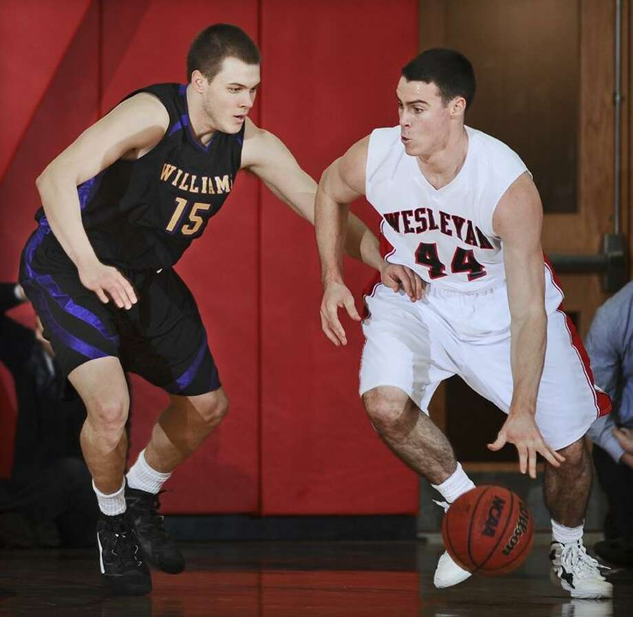 Wesleyan junior center Mike Callaghan was named NESCAC Player of the Week after helping the Cardinals to a pair of weekend wins to end the season. / STEVE MCLAUGHLIN