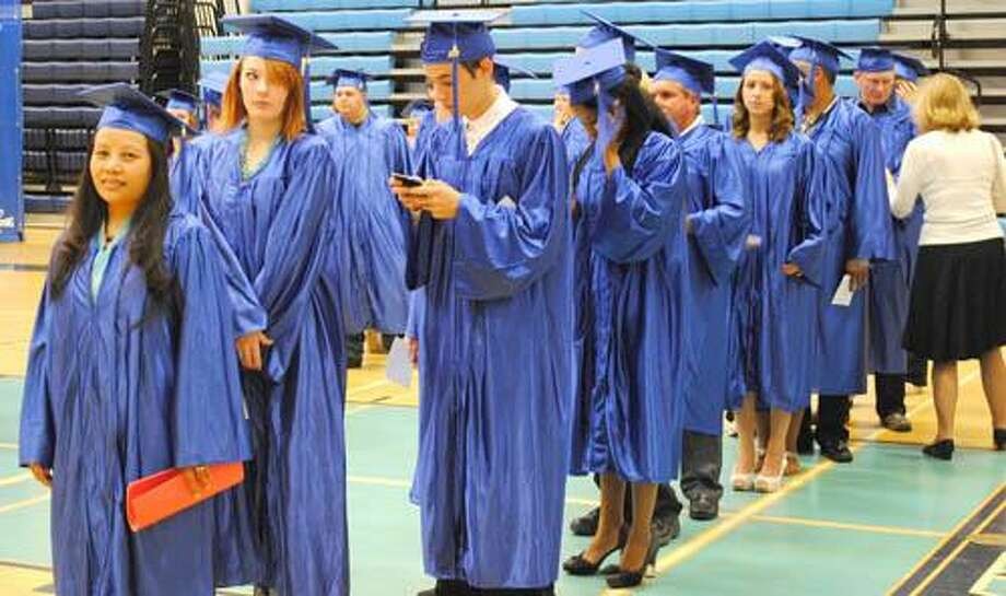 Students line up in the Middletown High School gym before the walk to the auditorium to get their diplomas. (Photo by Viktoria Sundqvist)