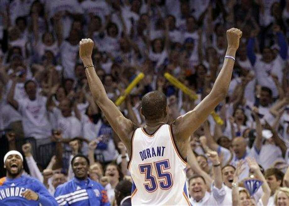 Oklahoma City Thunder small forward Kevin Durant (35) celebrates against the San Antonio Spurs during the second half of Game 6 in the NBA basketball Western Conference finals, Wednesday, June 6, 2012, in Oklahoma City. The Thunder won 107-99. (AP Photo/Eric Gay) Photo: AP / AP