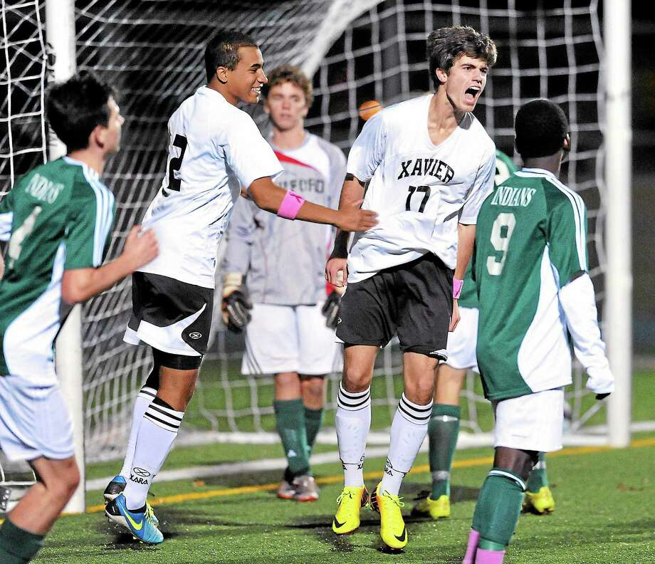 Wesley Reid (right) of Xavier celebrates after scoring against Guilford in the first half of the SCC Soccer Championship in East Haven on 10/30/2013. Photo: Arnold Gold — New Haven Register