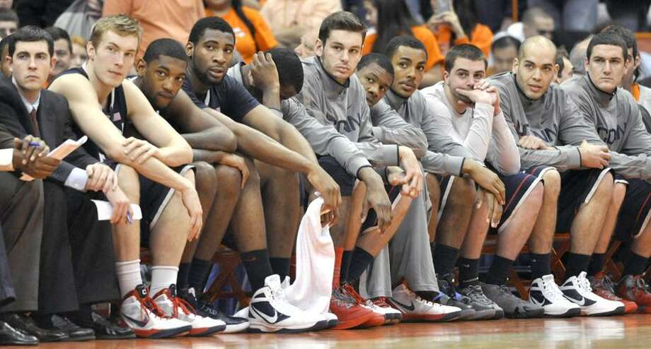 Connecticut players look on during the final seconds of an NCAA college basketball game against Syracuse in Syracuse, N.Y., Saturday, Feb. 11, 2012.   Syracuse wonin 85-67 (AP Photo/Kevin Rivoli) Photo: AP / FR60349 AP