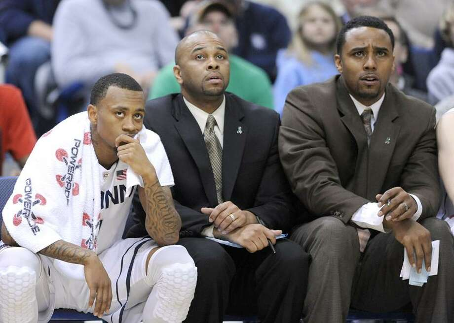 Connecticut's Ryan Boatright, and coaches Ricky Moore, and Kevin Freeman, left to right, react late in their team's 70-61 loss to Villanova in an NCAA college basketball game in Hartford, Conn., Saturday, Feb. 16, 2013. (AP Photo/Fred Beckham) Photo: AP / AP2013
