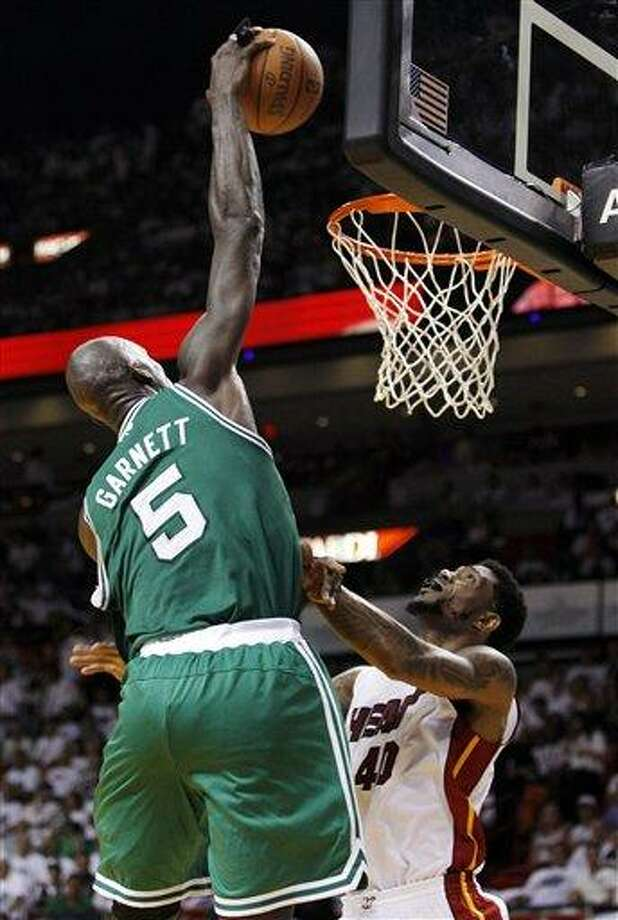 Boston Celtics' Kevin Garnett (5) dunks over Miami Heat's Udonis Haslem (40) during the second half of Game 5 in their NBA basketball Eastern Conference finals playoffs series against the Miami Heat, Tuesday, June 5, 2012, in Miami. (AP Photo/Lynne Sladky) Photo: AP / AP