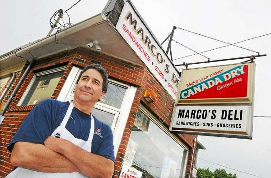 Catherine Avalone/The Middletown Press Middletown resident Mark Sbona, owner of Marco's Deli on William Street in Middletown will close shop after 18 years on Friday. / TheMiddletownPress