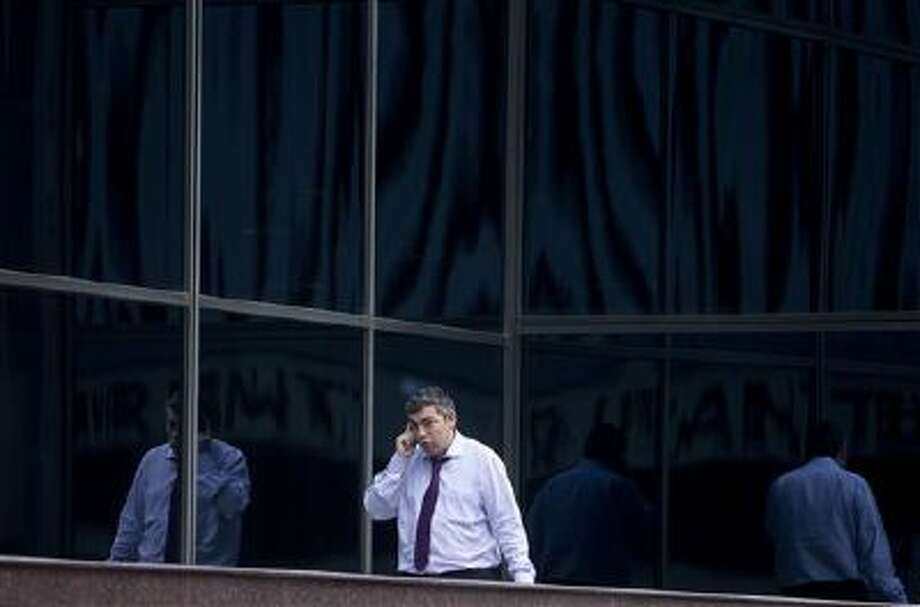 A man speaks on a cell phone in the business district of Madrid. A Spanish newspaper published a document Monday that it said shows the U.S. National Security Agency spied on more than 60 million phone calls in Spain in one month alone. It's the latest revelation about alleged massive U.S. spying on allies. Photo: AP / AP