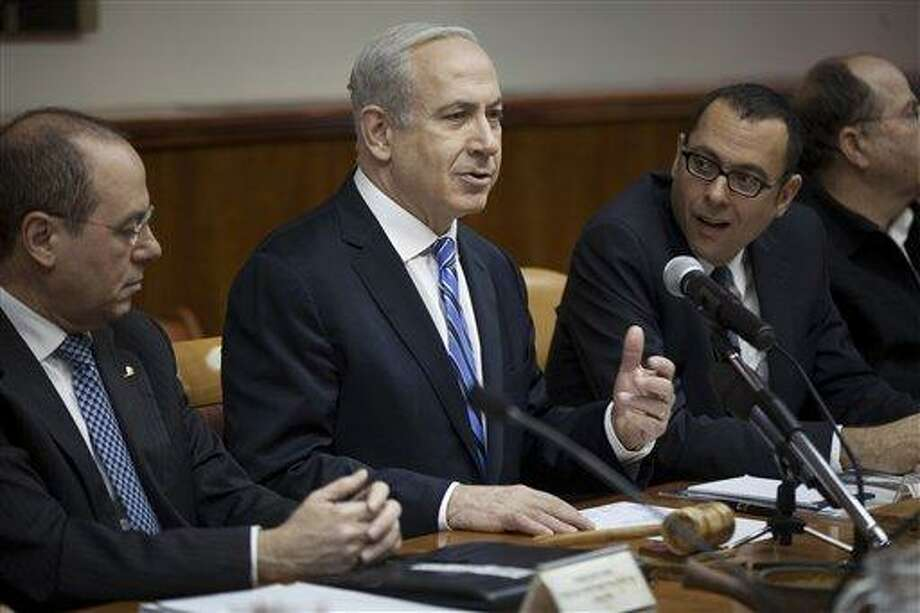 Israeli Prime Minister Benjamin Netanyahu, center, heads the weekly cabinet meeting in his office in Jerusalem. .AP Photo/Uriel Sinai. Photo: AP / Getty Images