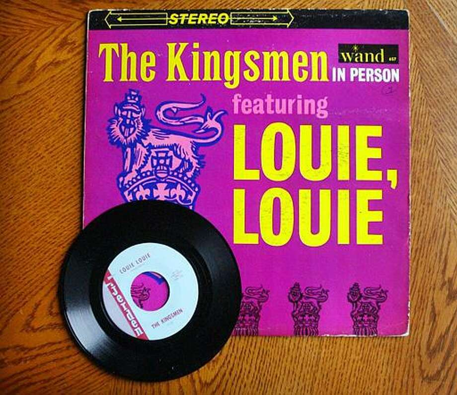 "An album and single of the hit recording ""Louie Louie,"" are among the items scheduled for auction Monday on the Internet site eBay, as seen Thursday, Dec. 4, 2003, in Redmond, Wash. Jerry Dennon was only 23 when he brought five high school kids into a Portland, Ore., studio to record a song that would become one of the country's most famous, a staple of fraternity parties and baseball stadium loudspeakers for decades to come. It's now 40 years since the Kingsmen's version of ""Louie Louie"" broke through on a black Boston radio station, and Dennon is parting with his gold record of the hit and other mementos from the archives of Jerden Records, which helped popularize the garage-rock ""Northwest sound"" of the 1960s. (AP Photo/Elaine Thompson) Photo: ASSOCIATED PRESS / AP2003"