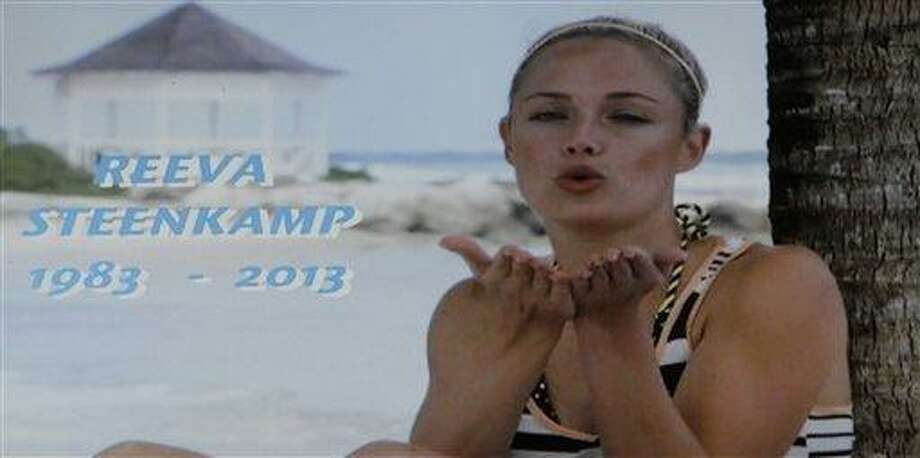"In this frame-grab from state television channel SABC 1 a tribute is devoted to slain model Reeva Steenkamp, girlfriend of Olympic athlete Oscar Pistorius. South Africa?s national broadcaster went ahead with the screening of  the  reality TV show ""Tropica Island of Treasure"" Saturday, Feb 16, 2013, featuring the dead model. Steenkamp encouraged her family to watch in one of her last conversations with them before her shooting death at the  home of Pistorius. AP Photo/Denis Farrell Photo: AP / AP"