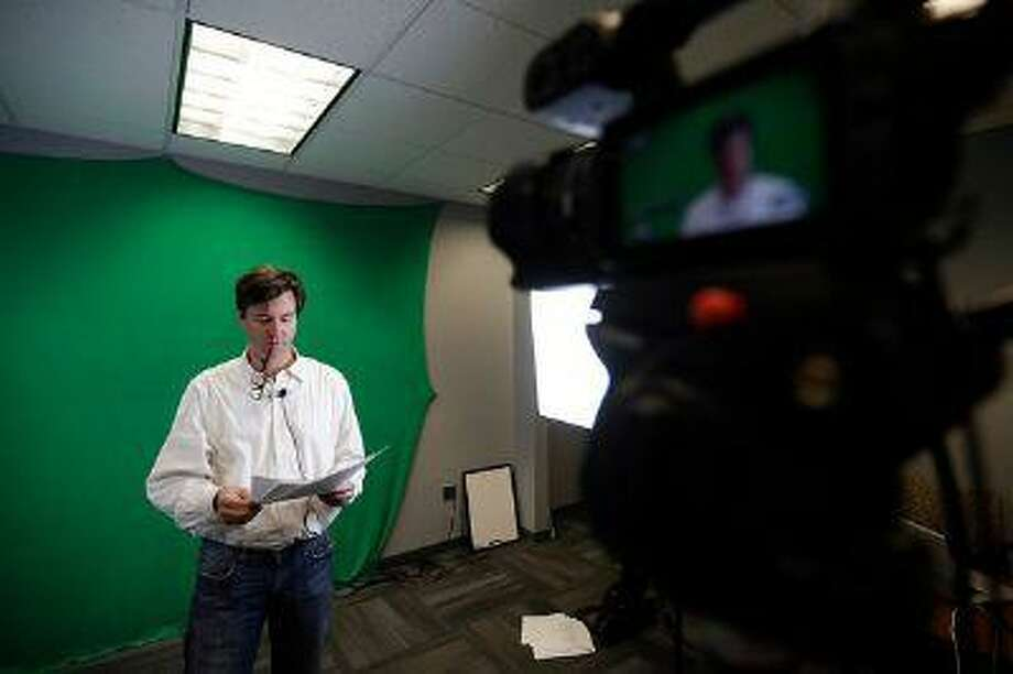 """In this photo taken Nov. 15, 2012, Peter Struck, Associate Professor of Classical Studies at the University of Pennsylvania prepares to record a lecture on Greek Mythology in Philadelphia. In 15 years of teaching, Struck has guided perhaps a few hundred students annually in his classes on Greek and Roman mythology through the works of Homer, Sophocles, Aeschylus and others -- """"the oldest strands of our cultural DNA."""" But if you gathered all of those tuition-paying, in-person students together, the group would pale in size compared with the 54,000 from around the world who, this fall alone, are taking his class online for free -- a """"Massive Open Online Course,"""" or MOOC, offered through a company called Coursera. (AP Photo/Matt Slocum) Photo: AP / 2012 A"""