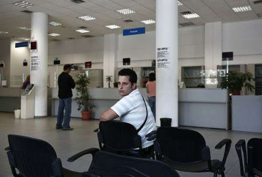 Greek Vangelis Xideas, 25, waits inside a Greek Manpower Employment Organisation office at a suburb of Athens June 14, 2013. Xideas has studied Accounting at the Technological Educational Institute of Mesolonghi and is looking for a job doing anything. (REUTERS/Yorgos Karahalis) Photo: REUTERS / X90075