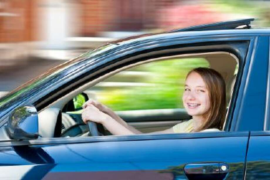 American teenagers are increasingly uninterested in driving, according to a new report that attributes a drop in driver's licenses to the flagging economy. Photo: Getty Images/Tetra Images RF / Tetra images RF