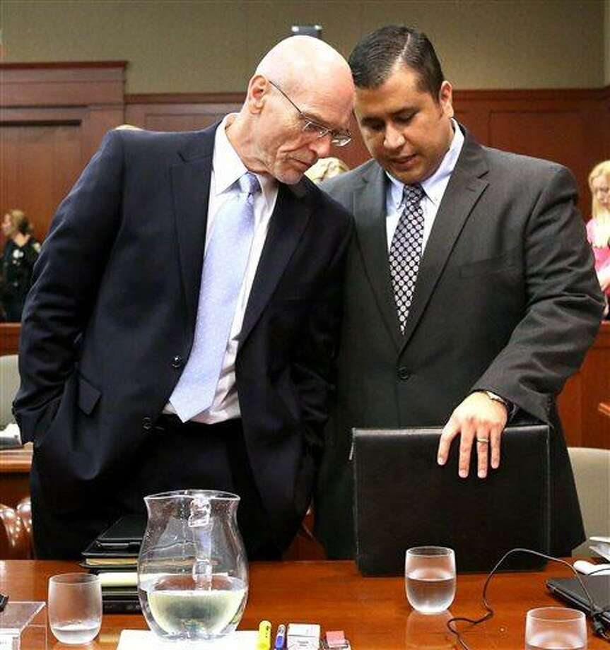 George Zimmerman, right, talks with defense attorney Don West in Seminole circuit court  in Sanford, Fla., Monday, June 24, 2013. Zimmerman has been charged with second-degree murder for the 2012 shooting death of Trayvon Martin. (AP Photo/Orlando Sentinel, Joe Burbank,Pool) Photo: AP / Pool Orlando Sentinel