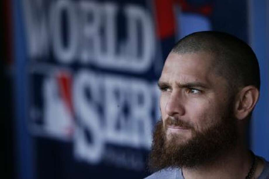 Boston Red Sox's Jonny Gomes looks out of the dugout before Game 5 of the World Series.
