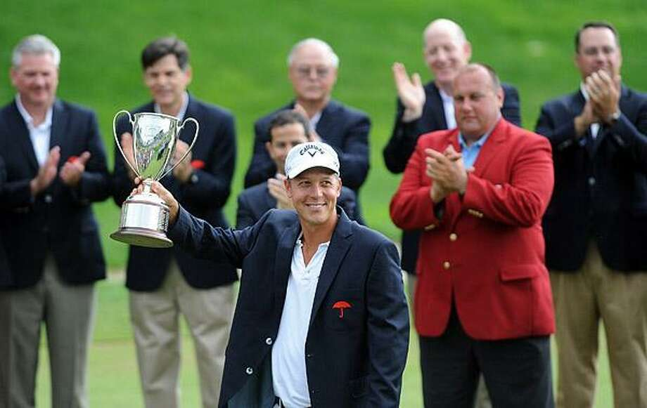 Cromwell--Fredrik Jacobson holds up the Championship Trophy after winning the 2011 Travelers Championship. Photo-Peter Casolino/New Haven RegisterCas110626   6/26/11