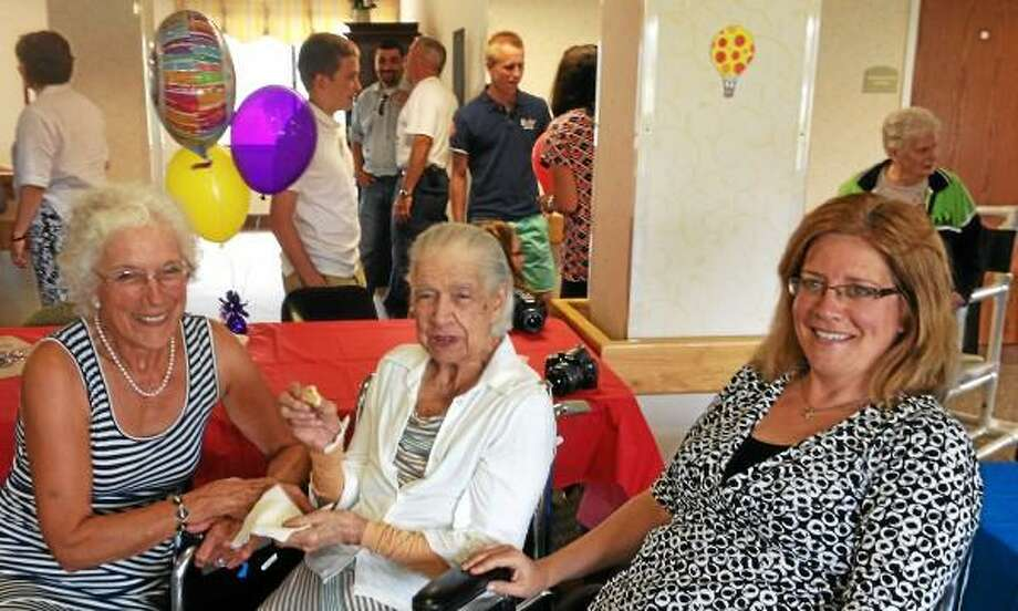 Alex Gecan/The Middletown Press Myrtle Grace (center) celebrated her 100th birthday Tuesday with her daughter, Theresa Grace Martin (left) and granddaughter, Karen Grace Ambler.