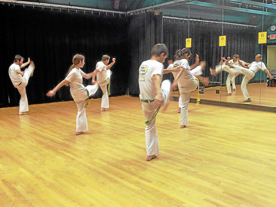 Capoeiristas rehearse moves at the Green Street Arts Center. Photo: Kerry Kincy - Special To The Press