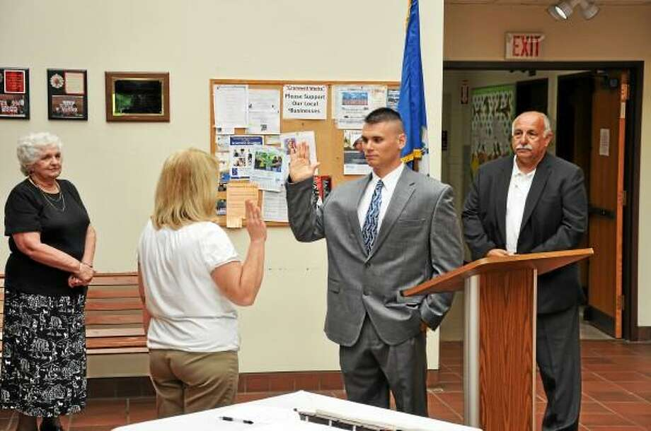 Submitted photo Daniel Howley is sworn in as a police officer in Cromwell while First Selectman Mertie Terry and Police Chief Anthony J. Salvatore Jr. watch.