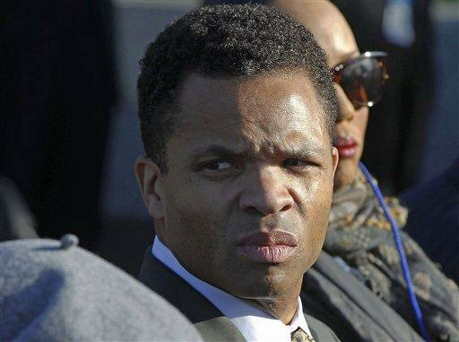 Rep. Jesse Jackson, Jr., D-Ill., attends the dedication of the Martin Luther King Jr. Memorial in Washington.   For all the talk of Jesse Jackson Jr. aspiring to be a U.S. senator or mayor of the nation?s third-largest city, his career wasn?t ended by attempts to amass political power.  Instead, it was the former congressman?s desire for flashy items like a gold-plated Rolex watch and furs, and collectibles, such as Eddie Van Halen?s guitar. AP Photo/Charles Dharapak Photo: AP / AP