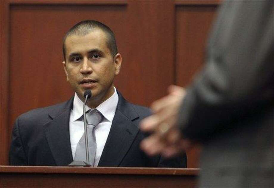 George Zimmerman, left, answers a question April 20 from attorney Mark O'Mara during a bond hearing in Sanford, Fla. A judge on Friday revoked Zimmerman's bond and ordered him returned to jail within 48 hours. Circuit Judge Kenneth Lester said Zimmerman misled the court about how much money he had available when his bond was set for $150,000 in April. Prosecutors claim Zimmerman had $135,000 available that had been raised by a website he set up. Associated Press Photo: AP / AP2012