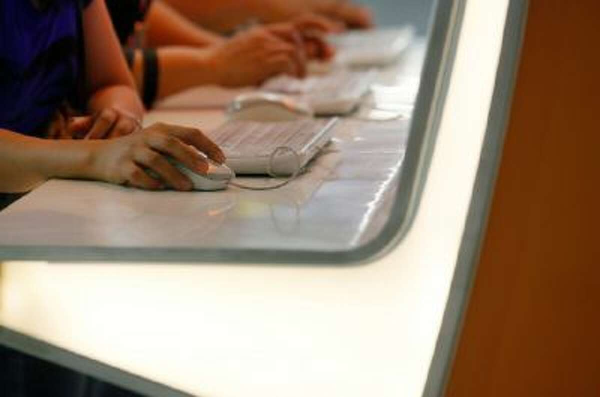 Internet users browse their Facebook website using a free wifi internet service.